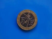 10法郎硬币,在蓝色的法国 库存照片