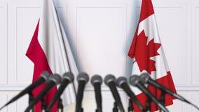 波兰和加拿大的旗子在国际会议或交涉新闻招待会 影视素材