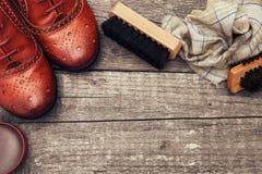 波兰奶油和刷子鞋子的 库存照片