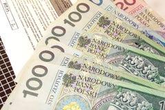 波兰报税表(PIT-11)和波兰金钱 库存照片