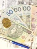 波兰报税表(PIT-11)和波兰金钱 免版税库存照片