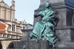 波兰,克拉科夫- 2015年1月03日:诗歌谬斯与孩子的作为亚当・密茨凯维奇纪念碑的元素 图库摄影