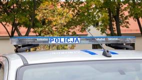 波兰,波兹南- 2016年10月1日 Policja -在汽车的标志波兰警察 库存照片