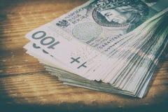 波兰货币PLN,金钱 100个PLN钞票文件卷擦亮兹罗提 免版税库存照片