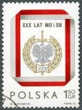 波兰- 1974年:展示民事民兵和安全部门证章,致力了第30周年 免版税库存图片