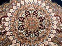 波斯地毯圈子形状 库存照片