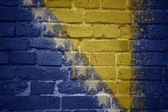 波斯尼亚黑塞哥维那的被绘的国旗在砖墙上的 图库摄影