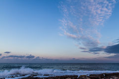 波浪和云彩 库存照片