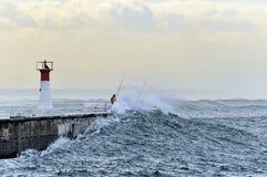 波浪和渔夫 库存照片