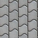 波浪形式的灰色铺路板 免版税库存照片