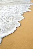 波浪沙子 免版税库存照片