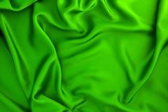 波浪绿色丝绸或缎织品背景 免版税库存图片