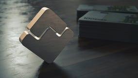 波浪cryptocurrency金属标志特写镜头 3d?? 免版税库存图片
