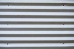 波纹状的金属房屋板壁 免版税库存图片