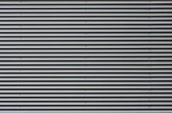 波纹状的金属板门面 库存图片