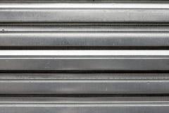 波纹状的金属银纹理 免版税库存图片