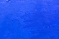 水泥墙壁上色有蓝色油漆背景 纹理 库存照片