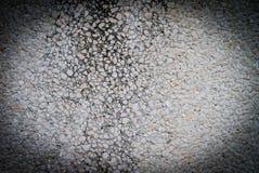 水泥墙壁纹理申请与小卵石 图库摄影