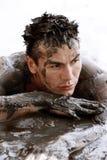 泥泞的人 图库摄影