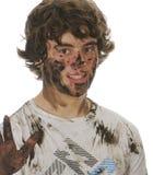 泥泞的男孩 库存照片