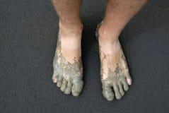 泥泞的英尺 免版税图库摄影