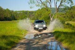泥泞的路地形通信工具 库存图片