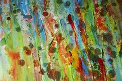 泥泞的金黄蜡状的绿色红色油漆摘要背景 图库摄影