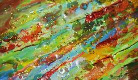 泥泞的金黄蜡状的绿色背景,油漆纹理 库存图片