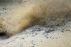 泥飞溅 免版税库存照片