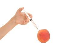 注射桃子毒物的医生 库存图片