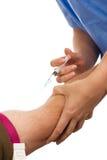 注射静脉内患者的医生药物 库存图片