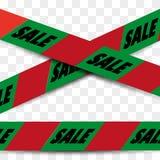 注意危险在圣诞节colur的销售磁带 免版税库存图片