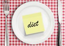 注意在板材的贴纸,饮食概念 免版税库存照片