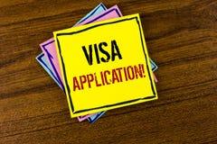 注意显示签证申请诱导电话 提供您的基本信息writte的企业照片陈列的板料 库存照片