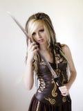 注视入您的灵魂的受伤的战士公主玩具 免版税库存照片