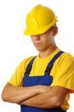 注视安全帽他的在下拉式工作者 免版税库存照片