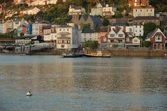 注视着横跨河箭出海口的看法日落 图库摄影