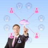 注视遥远地选择工作者的经理通过云彩 库存照片