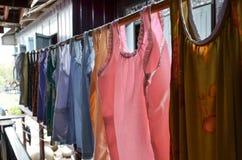 泰国传统衣裳垂悬 免版税库存照片