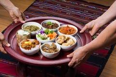 泰国传统食物餐具叫` Kantoke晚餐` 免版税库存照片