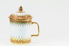 泰国古色古香的在白色背景的瓷水杯 库存图片