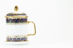 泰国古色古香的在白色背景的瓷水杯 免版税库存照片