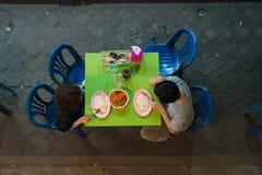 泰国在塑料袋的街道food.curry装箱 免版税库存图片