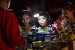 泰国小女孩预定的薄煎饼 图库摄影