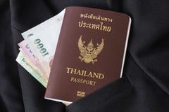 泰国护照和金钱在衣服 免版税库存图片