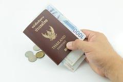 泰国护照在手边人 库存照片