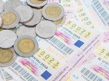 泰国抽奖券和硬币 库存图片