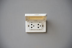 泰国有盖子保护的插座插口 库存图片