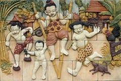 泰国样式手工造泰国文化比赛在墙壁上的 免版税库存图片