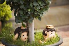 泰国的家庭装饰的逗人喜爱的婴孩玩偶 库存图片